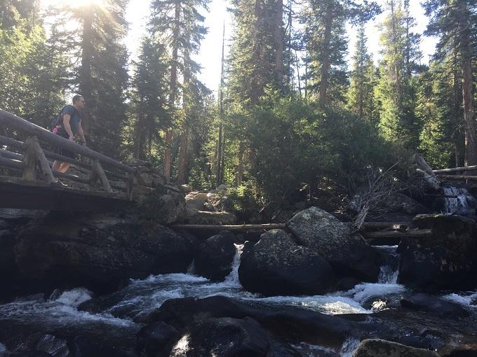 Wooden bridge crossing river in Wild Basin in Rocky Mountain National Park