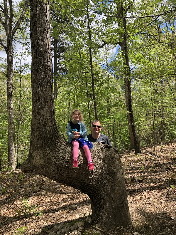 family hiking pigeon roost trail in hobbs state park - northwest arkansas