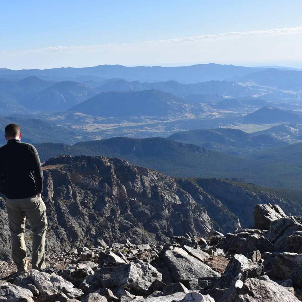 Eric on the summit of Hallett Peak