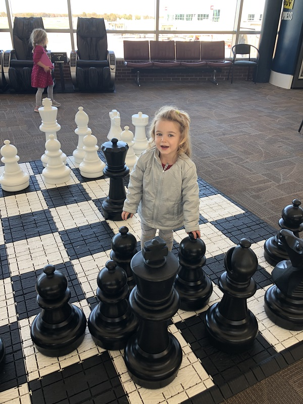 Family amenities at XNA include a giant chess board